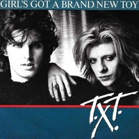 Girl's got a brand new toy \ Hot was the rainy night - T.X.T.