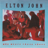 Who wears the shoes \ Tortured - ELTON JOHN